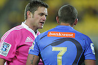 Referee Nick Briant chats with Force captain Matt Hodgeson during the Super Rugby match between the Hurricanes and Western Force at Westpac Stadium, Wellington, New Zealand on Friday, 19 April 2013. Photo: Dave Lintott / lintottphoto.co.nz