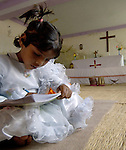 A Pakistani girl studying in a school for poor children held in St. Mathew's Church in the Punjab village of Bajasinsingh. This school is sponsored by the Church of Pakistan.