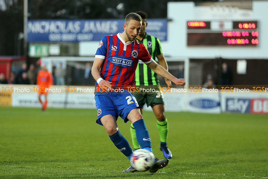 Luke Pennell of Dagenham and Redbridge and Lyle Taylor of AFC Wimbledon during Dagenham and Redbridge vs AFC Wimbledon, Sky Bet League 2 Football at the Chigwell Construction Stadium on 19th April 2016