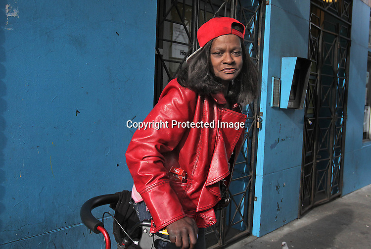 A woman poses for a street portrait in the Tenderloin of San Francisco, CA.