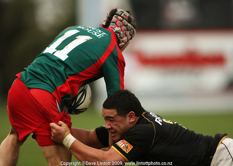 Wellington number eight Matthew Luamanu tries to tackle Nick Olson during the Ranfurly Shield rugby match between the Wellington Lions and Wairarapa Bush at Trust House Memorial Park, Masterton, New Zealand on Saturday, 27 September 2008. Photo: Dave Lintott / lintottphoto.co.nz