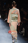 "Model walks runway in a ""Sun"" silk kimono from the Hiromi Asai Fall Winter 2016 ""Spirit of the Earth"" collection by Hiromi Asai & Kimono Artisan Kyoto, presented at NYFW: The Shows Fall 2016, during New York Fashion Week Fall 2016."