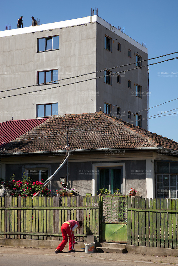 Romania. Iași County. Iasi. Architectural contrast. A woman is cutting weeds in front of her house while workers are on the roof of a building. Iași (also referred to as Iasi, Jassy or Iassy) is the largest city in eastern Romania and the seat of Iași County. Located in the Moldavia region, Iași has traditionally been one of the leading centres of Romanian academic life. The city was the capital of the Principality of Moldavia from 1564 to 1859, then of the United Principalities from 1859 to 1862, and the capital of Romania from 1916 to 1918. 9.06.15 © 2015 Didier Ruef