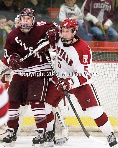 Austin Smith (Colgate - 9), Dan Ford (Harvard - 5) - The Harvard University Crimson defeated the visiting Colgate University Raiders 6-2 (2 EN) on Friday, January 28, 2011, at Bright Hockey Center in Cambridge, Massachusetts.