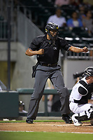 Home plate umpire Jose Navas calls a batter out on strikes during the International League game between the Scranton/Wilkes-Barre RailRiders and the Charlotte Knights at BB&T BallPark on August 14, 2019 in Charlotte, North Carolina. The Knights defeated the RailRiders 13-12 in ten innings. (Brian Westerholt/Four Seam Images)