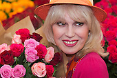London, UK, 18 May 2013. Joanna Lumley at the Marks & Spencers's stand with roses. Press preview day at the RHS Chelsea Flower Show, London.