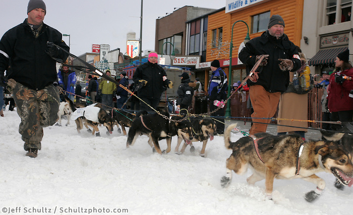 Matt Hayashida's handlers take his dogs to the start line in Anchorage on Saturday March 1st during the ceremonial start day of the 2008 Iidtarod Sled Dog Race.