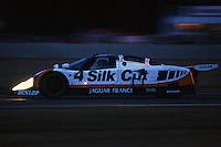 LE MANS, FRANCE - JUNE 11: The Jaguar XJR-9 LM TWR-J12C-287 of Michel Ferté, Eliseo Salazar and Alain Ferté is driven at dusk during the 24 Hours of Le Mans at the Circuit de la Sarthe in Le Mans, France, on June 11, 1989.
