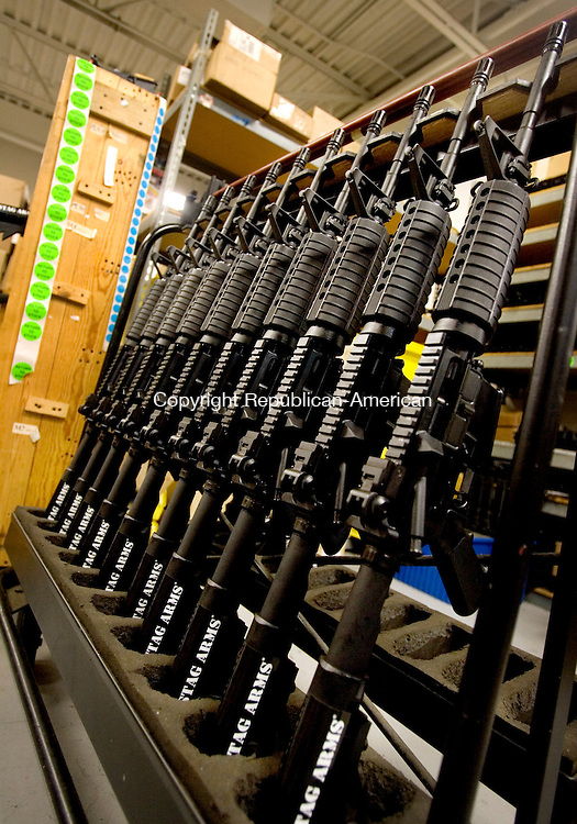 NEW BRITAIN, CT. 20 February 2013-022013SV04-A row of AR-15s wait at the end of assembly line for shipment at Stag Arms in New Britain Wednesday. Stag Arms is the leading maker of AR-15 rifles. .Steven Valenti Republican-American