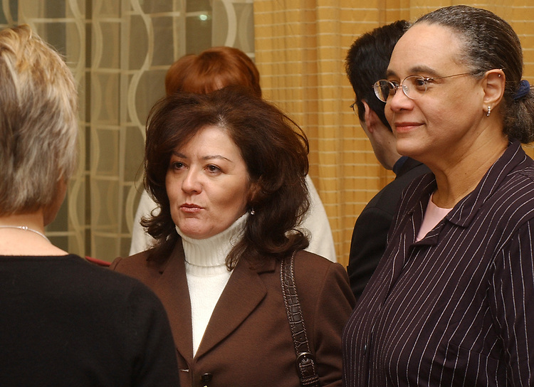 Edna Negron and Joye Brown at retirement party for Harvey Aronson at the Huntington Hilton in Melville on Thursday January 20, 2005. (Photo copyright Jim Peppler 2005).