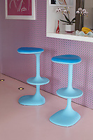 Close up of a pair of bright blue stools by the breakfast bar