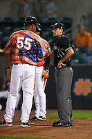 Aberdeen Ironbirds manager Luis Pujols (55) argues a call with umpire Anthony Perez as Ricardo Andujar (18) looks on during a game against the Tri-City ValleyCats on August 6, 2015 at Ripken Stadium in Aberdeen, Maryland.  Tri-City defeated Aberdeen 5-0 in a combined no-hitter.  (Mike Janes/Four Seam Images)