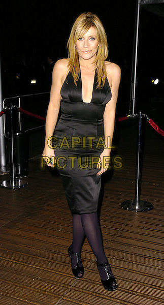 MICHELLE COLLINS.The National Youth Theatre 50th Anniversary Gala Dinner,.Battersea Evoloution, Battersea Park, London, England,.November 12th 2006..full length black dress halterneck tights.Ref: CAN.www.capitalpictures.com.sales@capitalpictures.com.©Can Nguyen/Capital Pictures