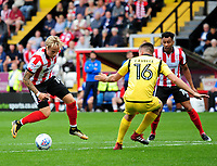 Lincoln City's Jordan Maguire-Drew vies for possession with Morecambe's Sam Lavelle<br /> <br /> Photographer Andrew Vaughan/CameraSport<br /> <br /> The EFL Sky Bet League Two - Lincoln City v Morecambe - Saturday August 12th 2017 - Sincil Bank - Lincoln<br /> <br /> World Copyright &copy; 2017 CameraSport. All rights reserved. 43 Linden Ave. Countesthorpe. Leicester. England. LE8 5PG - Tel: +44 (0) 116 277 4147 - admin@camerasport.com - www.camerasport.com