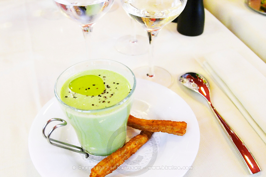 A starter dish, cold green pea soup with olive oil and small churros with sesame seeds, the restaurant Blanc Le Bistrot in Toulon, very design art-deco Toulon Var Cote d'Azur France