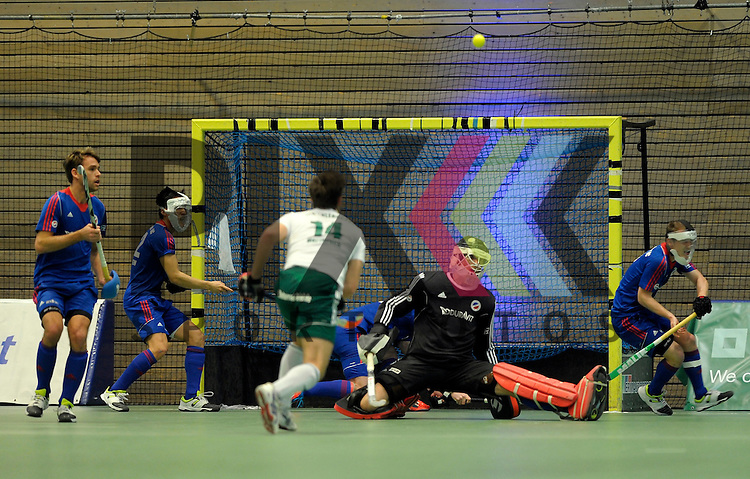 GER - Luebeck, Germany, February 06: During the 1. Bundesliga Herren indoor hockey semi final match at the Final 4 between Uhlenhorst Muelheim (white) and Mannheimer HC (blue) on February 6, 2016 at Hansehalle Luebeck in Luebeck, Germany.  Final score 2-3 (HT 7-5).  (L-R) Florian Woesch #25 of Mannheimer HC, Danny Nguyen Luong #22 of Mannheimer HC, Timm Herzbruch #14 of HTC Uhlenhorst Muehlheim, Andreas Spaeck #1 of Mannheimer HC, Jan Philipp Fischer #2 of Mannheimer HC<br /> <br /> Foto &copy; PIX-Sportfotos *** Foto ist honorarpflichtig! *** Auf Anfrage in hoeherer Qualitaet/Aufloesung. Belegexemplar erbeten. Veroeffentlichung ausschliesslich fuer journalistisch-publizistische Zwecke. For editorial use only.