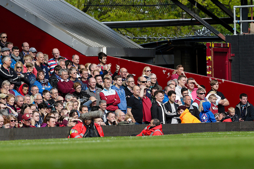 Burnley fans look on during the game<br /> <br /> Photographer Craig Mercer/CameraSport<br /> <br /> Football - Barclays Premiership - West Ham United v Burnley - Saturday 2nd May 2015 - Boleyn Ground - London<br /> <br /> &copy; CameraSport - 43 Linden Ave. Countesthorpe. Leicester. England. LE8 5PG - Tel: +44 (0) 116 277 4147 - admin@camerasport.com - www.camerasport.com