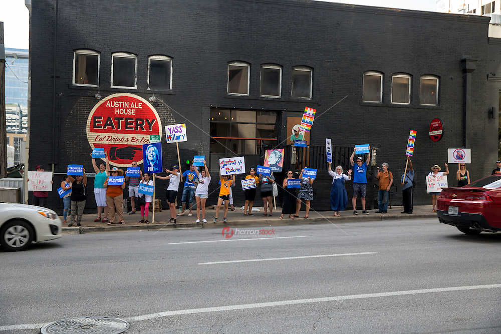 Austin, Texas - Tues., August 23, 2016 - Protesters of Republican presidential candidate Donald Trump line Lavaca street and hold up signs to vehicles passing by in downtown Austin to protest Trump's visit to the capital city. <br /> <br /> Use of this image in advertising or for promotional purposes is prohibited.<br /> <br /> Editorial Credit: Dan Herron / Herronstock Editorial.