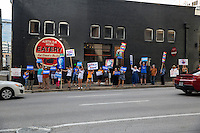 Austin, Texas - Tues., August 23, 2016 - Protesters of Republican presidential candidate Donald Trump line Lavaca street and hold up signs to vehicles passing by in downtown Austin to protest Trump's visit to the capital city. <br />