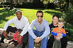 "General Hospital's Scott Reeves ""Dr. Steven Lars-Webber"" is the Celebrity Grand Marshal and Sports Celebrity Virginia Tech, NFL, WFL wide receiver Shawn Scales sitting on the curb waiting for the parade to start pose with Shawn's daughter Morgan and Beth and son Ethan at the 33rd Annual Mountain State Apple Harvest Festival (MSAHF) 2012 parade on October 20, 2012 as well as attending the Bob Elmer Celebrity Sports Breakfast sponsored by the Rotary Club and the Queen's Grand Ball at the Historic Shenandoah Hotel in Martinsburg, West Virginia. (Photo by Sue Coflin/Max Photos)"