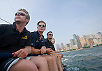 The Tutima DK-46, Bjarne Lorenzen (CQ), left, Mario Lilie (CQ), second from left, Stefan Stange (CQ), second from right and Jan Brugge (CQ), far right, sit on the port side of the racing yacht as it passes in front of  the Manhattan skyline Thursday, June 7, 2007 in New York Harbor. The German based 46 foot yacht was visiting New York prior to its 3600 mile race across the atlantic ocean which begins June 16, 2007 in Newport, R.I. (Photo/ Victoria Arocho, Rocka*Rho Publishing)
