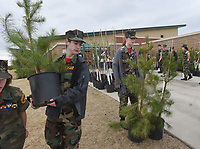 NWA Democrat-Gazette/FLIP PUTTHOFF <br /> TREES FOR THE ASKING<br /> Jake Provenza (left) with the Young Marines youth organization carries a free tree for a customer on Saturday April 14 2018 during the City of Bentonville tree giveaway at the Bentonville Community Center on Southwest I Street. The event distributed 400 trees of several varieties to Bentonville residents, said David Short, with the city tree and landscaping committee. Residents could pre-register to get two free trees and choose the variety they like. Some trees were available on a first-come, first-served basis. The event was the 15th year in a row for the tree giveaway, which is held twice each year.