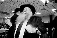"""Milano: comunita' LUBAVITCH, Il rabbino  MASH GHIACH balla durante la  festa di SUKKOT (delle capanne).  Festa di ringraziamento e gioia dopo i giorni di pentimento ed espiazione (Rosh Hashana' e Yom Kippur). Storicamente ricorda le capanne che gli antenati costruirono durante la permanenza nel deserto dopo la cacciata dall'Egitto.Milan: LUBAVITCH community, Rabbi MASH GHIACH dancing during the feast of SUKKOT. The word """"Sukkot"""" means """"booths,"""" and refers to the temporary dwellings that the Jews are commanded to live in during this holiday in memory of the period of wandering after the expulsion from Egypt....."""