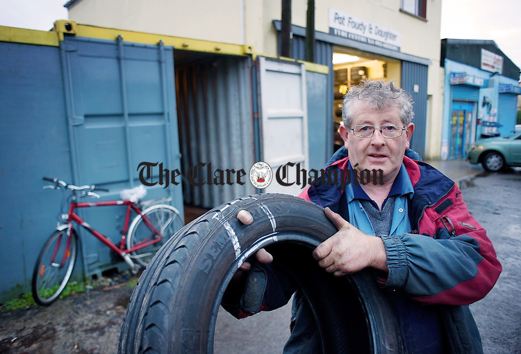 Ennis tyre repair man Pat Foudy manages to get his finger through the wall of a of tyres he replaced after the driver came in contact with a series of pot holes on the Lahinch road at Claureen. Photograph by John Kelly.