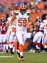 CLEVELAND, OH - AUGUST 18, 2016: Linebacker Tank Carder #59 of the Cleveland Browns runs off the field in the first quarter of a preseason game on August 18, 2016 against the Atlanta Falcons at FirstEnergy Stadium in Cleveland, Ohio. Atlanta won 24-13.  (Photo by: 2016 Nick Cammett/Diamond Images) *** Local Caption *** Tank Carder