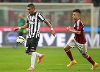 Calcio, Serie A: Milan vs Juventus, Milano, stadio San Siro, 20 settembre 2014.<br /> Juventus midfielder Roberto Pereyra, of Argentina, is chased by AC Milan forward Stephan El Shaarawy, right, during the Italian Serie A football match between AC Milan and Juventus at Milan's San Siro stadium, 20 September 2014.<br /> UPDATE IMAGES PRESS/Isabella Bonotto