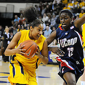 Marquette University's Angel Robinson heads for the basket against Uconn Connecticut Huskies Kalana Greene during the first half of the game Saturday, Feb. 7 at the McGuire Center in Milwaukee. Ernie Mastroianni photo.