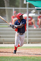 GCL Nationals center fielder Caldioli Sanfler (9) follows through on a swing during a game against the GCL Cardinals on August 5, 2018 at Roger Dean Chevrolet Stadium in Jupiter, Florida.  GCL Cardinals defeated GCL Nationals 17-7.  (Mike Janes/Four Seam Images)