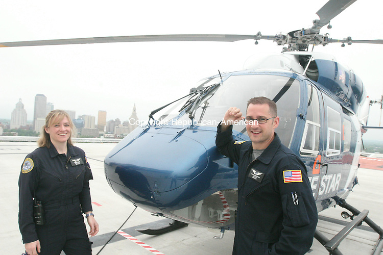 HARTFORD, CT - 11 June, 2009 - 061109MO01 - Flight nurse Chris Winebarger, right, and respiratory therapist Patricia Lohan stand next to the Life Star helicopter at Hartford Hospital Thursday.  Jim Moore Republican-American.