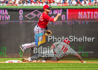 15 September 2013: Washington Nationals infielder Stephen Lombardozzi turns a double play to end the 4th inning against the Philadelphia Phillies at Nationals Park in Washington, DC. The Nationals took the rubber match of their 3-game series 11-2 to keep their wildcard postseason hopes alive. Mandatory Credit: Ed Wolfstein Photo *** RAW (NEF) Image File Available ***