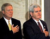 United States House Minority Leader Richard A. Gephardt (Democrat of Missouri) and U.S. House Speaker Newt Gingrich (Republican of Georgia) pay respects during the playing of the National Anthem prior to the Congressional Gold Medal Ceremony honoring President Nelson Mandela of South Africa in the U.S. Capitol Rotunda on September 23, 1998.<br /> Credit: Ron Sachs / CNP