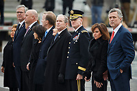 Former U.S. President George W. Bush and members of the Bush family watch as a joint services military honor guard carries the flag-draped casket of former U.S. President George H.W. Bush from the U.S. Capitol in Washington, Wednesday, Dec. 5, 2018. (Shawn Thew/Pool Photo via AP) / MediaPunch