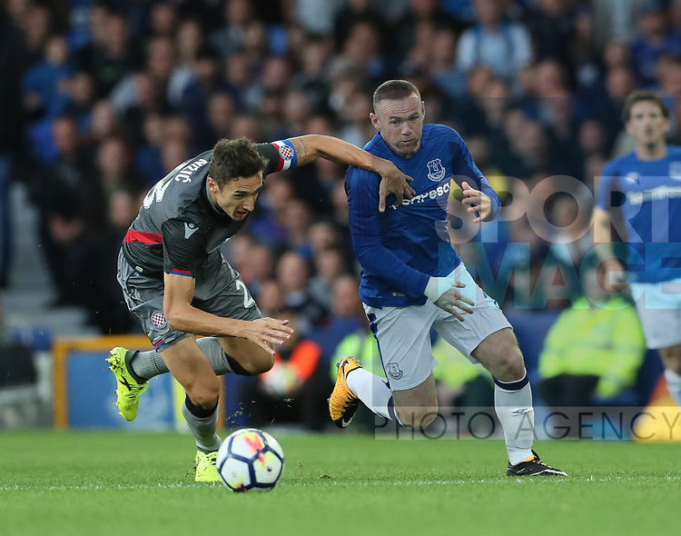 Wayne Rooney of Evertontakes on Zoran Nizic of Hajduk Split during the Europa League Qualifying Play Offs 1st Leg match at Goodison Park Stadium, Liverpool. Picture date: August 17th 2017. Picture credit should read: David Klein/Sportimage