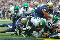 Annapolis, MD - October 26, 2019: Tulane Green Wave quarterback Justin McMillan (12) scores a touchdown during the game between Tulane and Navy at  Navy-Marine Corps Memorial Stadium in Annapolis, MD.   (Photo by Elliott Brown/Media Images International)