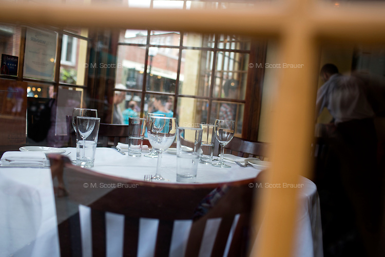 A dining table stands in a windowed area of  Terramia Ristorante on Salem Street in the North End of Boston, Massachusetts, USA.