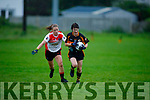 Marina Barry of Austin Stacks ahead of Neasa Ni Luing of  Corcha Duibhne in the Kerry Ladies Intermediate Football Championship.