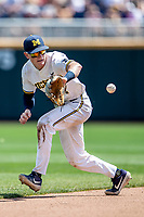 Michigan Wolverines shortstop Jack Blomgren (2) fields a ground ball against the Texas Tech Red Raiders in the NCAA College World Series on June 21, 2019 at TD Ameritrade Park in Omaha, Nebraska. Michigan defeated Texas Tech 15-3 and will play in the CWS Finals. (Andrew Woolley/Four Seam Images)