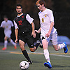 Brendan Wall #8 of Massapequa moves the ball downfield during the Nassau County Class AA varsity boys soccer playoffs against Syosset at Adelphi University on Sunday, Oct. 30, 2016. Thunder, lightning and heavy rain necessitated a delay nine minutes into the second half a scoreless match.
