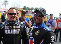 Feb 22, 2015; Chandler, AZ, USA; NHRA top fuel driver Antron Brown (right) and Tony Schumacher during the Carquest Nationals at Wild Horse Pass Motorsports Park. Mandatory Credit: Mark J. Rebilas-