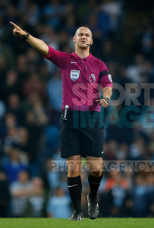 Referee Robert Madley during the Premier League match at the Eithad Stadium, Manchester. Picture date 21st August 2017. Picture credit should read: Simon Bellis/Sportimage