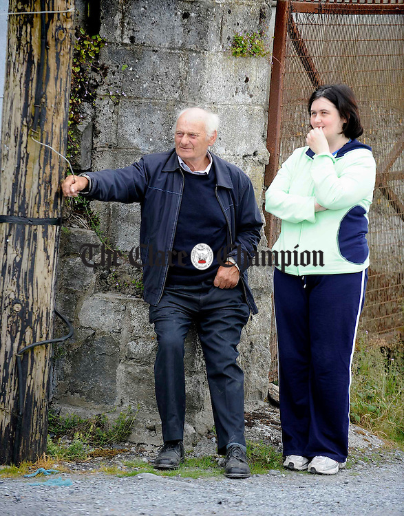 JJ Flanagan with his daughter Josephine watching the parade during the Clare County Fleadh at Kilfenora. Photograph by John Kelly.