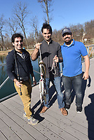 NWA Democrat-Gazette/FLIP PUTTHOFF <br /> Moji Abolhassani (from left), Mahmoud Moradi and Pasha Maleknia show some of the trout they caught Saturday Dec. 22 2018 at Lake Springdale. All three caught their limit of five rainbow trout.