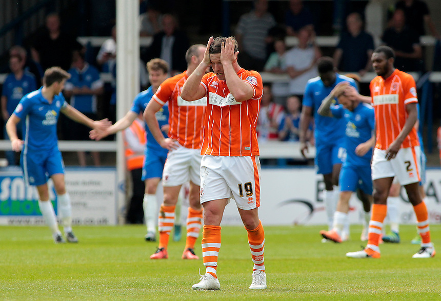 Blackpool&rsquo;s David Norris shows his frustration after Peterborough United score another goal<br /> <br /> Photographer David Shipman/CameraSport<br /> <br /> Football - The Football League Sky Bet League One - Peterborough United v Blackpool  - Sunday 8th May 2016 - ABAX Stadium - London Road   <br /> <br /> &copy; CameraSport - 43 Linden Ave. Countesthorpe. Leicester. England. LE8 5PG - Tel: +44 (0) 116 277 4147 - admin@camerasport.com - www.camerasport.com