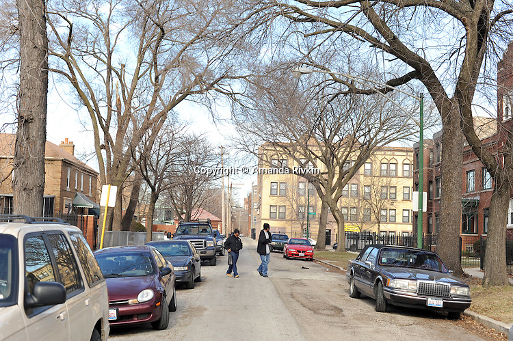People cross the block of South Euclid in the South Shore neighborhood where Michelle Obama's family house is in Chicago, Illinois on January 2, 2008.  Michelle Obama, wife of U.S. President Elect Barack Obama, was raised in a modest bungalow in the South Shore neighborhood on the South Side of Chicago.