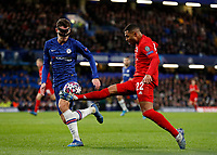 25th February 2020; Stamford Bridge, London, England; UEFA Champions League Football, Chelsea versus Bayern Munich; Serge Gnabry of Bayern Munich chipping the ball past Andreas Christensen of Chelsea