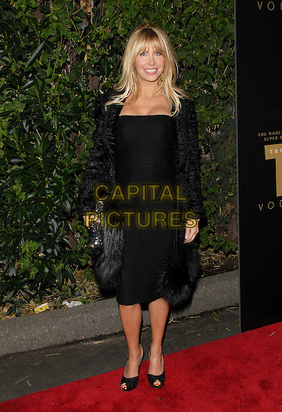 LISA GASTINEAU.Attends The Drinks America Launch Party for Trump Vodka held at Les Deux in Hollywood, California, USA. .January 17th, 2007.full length black skirt jacket coat fur velvet feather .CAP/DVS.©Debbie VanStory/Capital Pictures